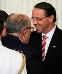 Deputy Attorney General Rosenstein talks with Rudy Giuliani after President Trump's Supreme Court nomination event at the White House in Washington