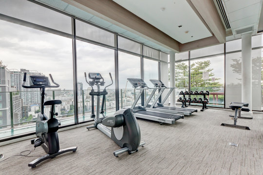 Gym fitness and equipment at sky view, on top modern condominium