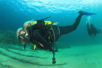 Blonde female scuba diver