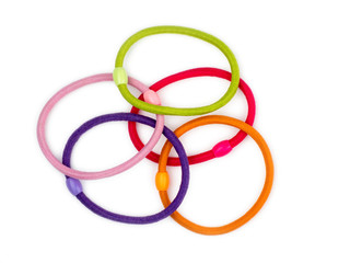 Colorful hair bands on white background.
