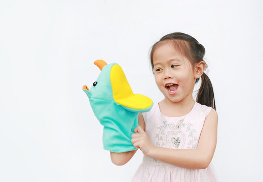 Little Asian child girl hand wear and playing Rhinoceros puppets on white background.