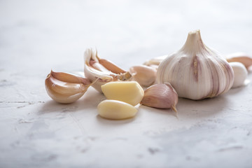 Group of garlic cloves scattered on a white background. Important ingredient in cuisines of the world. Healthy product.
