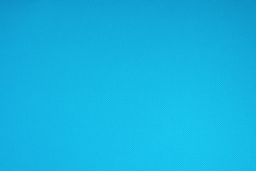 top view of blue surface with tiny white polka dot pattern for background