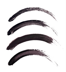 Vector make-up cosmetic mascara brush stroke texture design isolated on white. Realistic mascara smear set template. Mascara eyelashes brush stroke makeup. Black hand drawn lash scribble swatch