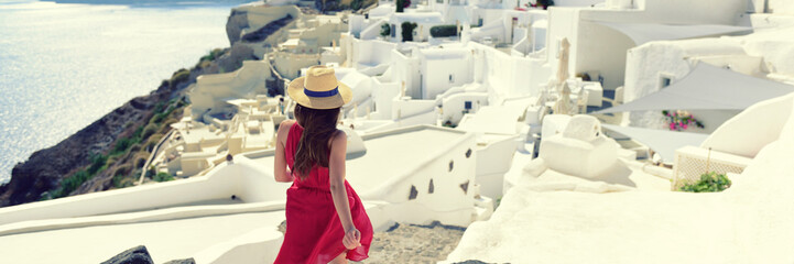 Luxury travel Europe tourist woman walking in Santorini streets - Summer vacation cruise destination. White village of Oia, Greece banner panorama.