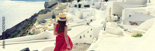 Wall mural Luxury travel Europe tourist woman walking in Santorini streets - Summer vacation cruise destination. White village of Oia, Greece banner panorama.
