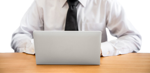 business man working on a laptop isolated on the white