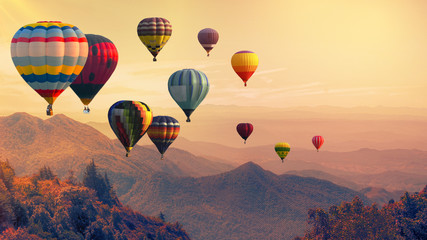 Canvas Prints Balloon Hot air balloon above high mountain at sunset