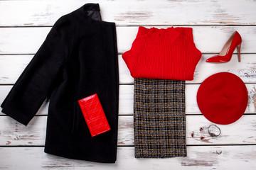 Fancy winter women's wardrobe with wallet. Red leather fancy heel women's shoe.
