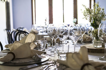 Decorated table on a wedding with wine glasses and blurred out background