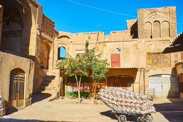 Old cart with mattresses in Hindu Caravanserai, Kerman, Iran