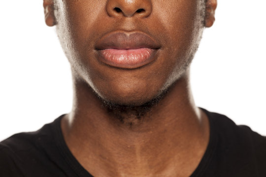 Mouth closeup of young black african american guy on white background
