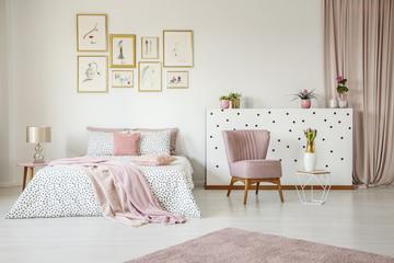 Pink spacious bedroom interior