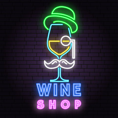 Retro neon wine sign on brick wall background.