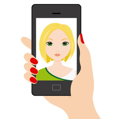 Young girl doing a selfie with smartphone