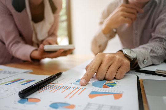 Business partnership analysis investment perform data document and calculating a valuation number