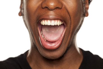 Open mouth closeup of young black african american guy on white background