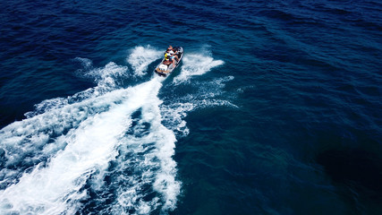 Top view of jet ski cruising in deep blue sea