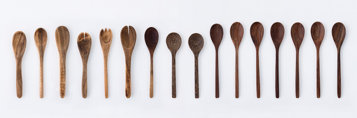 Kitchenware set of wooden fork, spoon and utensils on white background.