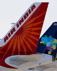 The logo of Air India is pictured on the tail of passenger aircraft on the tarmac in Colomiers near Toulouse