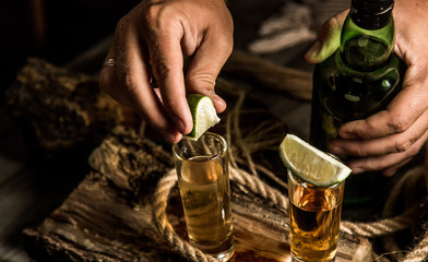 bartender adds lime to tequila