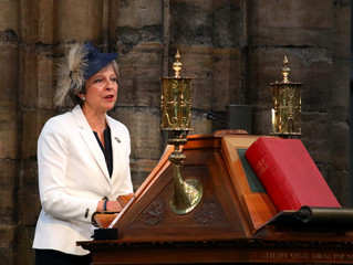Britain's Prime Minister, Theresa May, speaks at Westminster Abbey for a service to mark the centenary of the Royal Air Force, in central London