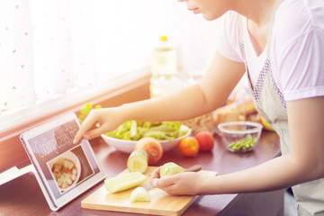Foto op Canvas Koken Asian woman prepare ingredients for cooking follow cooking class online course on website via tablet. cooking content on internet technology for modern lifestyle concept