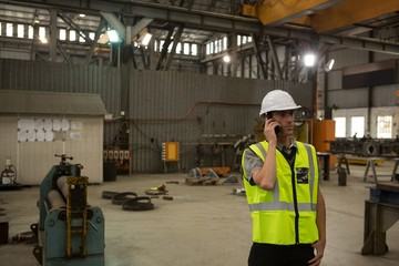 Marine engineer talking on mobile phone