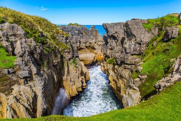 Pancake rocks form narrow fjords