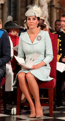 Britain's Catherine, Duchess of Cambridge, sits in Westminster Abbey for a service to mark the centenary of the Royal Air Force (RAF), in central London
