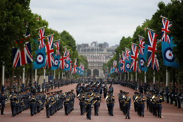 A military band marches along the Mall ahead of a flypast to mark the centenary of the Royal Air Force, in central London