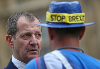 Pro-European supporters, in conversation with Labour Party supporter Alastair Campbell, demonstrate outside the Houses of Parliament in Westminster, London