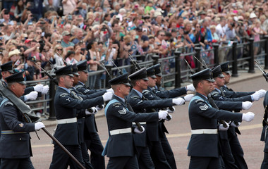 Members of the RAF Regiment marches along the Mall ahead of a flypast to mark the centenary of the Royal Air Force, in central London
