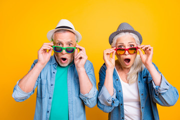Wow unbelievable! Success win winner victory facial expressing hipster concept. Close up photo portrait of two excited astonished scared beautiful handsome people touching glasses isolated background