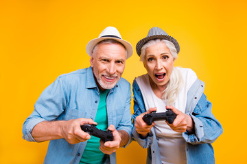 Remote controller wireless bluetooth champion celebrate victory concept. Close up photo portrait of two excited mad cheerful screaming nervous funky funny partners holding console isolated background