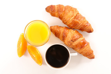 coffee cup, orange juice and croissant