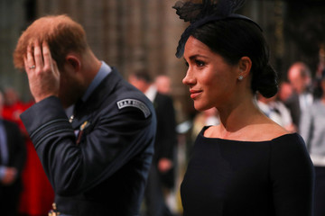 Britain's Meghan, the Duchess of Sussex and Prince Harry arrive at Westminster Abbey for a service to mark the centenary of the Royal Air Force in central London