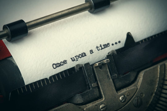 Close up of old typewriter covered with dust with Once upon a time text