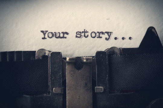 Your story... The text is typed on paper with an old typewriter, a vintage inscription, a story of life.