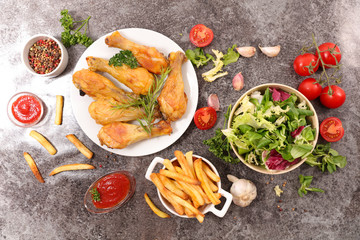 grilled chicken leg with french fries and salad