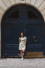 Pretty woman standing near ancient door