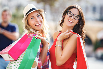 Beautiful Young Women Enjoying Shopping