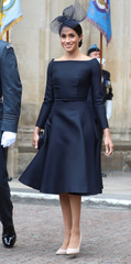 Britain's Meghan, the Duchess of Sussex leaves Westminster Abbey after a service to mark the centenary of the Royal Air Force in central London