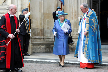 Britain's Queen Elizabeth leaves Westminster Abbey after a service to mark the centenary of the Royal Air Force in central London