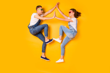 Friendship eyewear eyeglasses spectacles rest denim  outfit concept. Above full length size photo of two crazy mad excited stylish children building figure with body parts isolated bright background