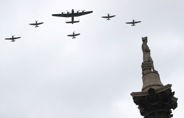 Vintage military aircraft perform a fly past over Trafalgar Square to mark the centenary of the Royal Air Force in central London