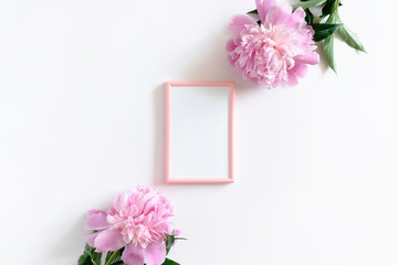 Picture frame mockup and pink peonies on a white background