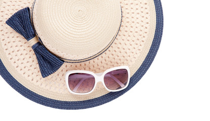 Summer hat with ribbon and sunglasses isolated on white background. Top view and copy space.