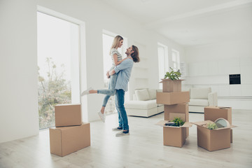 I want to live with you forever! Out dreams come true! Lifestyle modern stylish dreamy trendy loft flat concept. Adorable beautiful attractive excited cheerful joyful couple dancing in new house