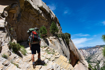 A lone hiker ascends to new heights